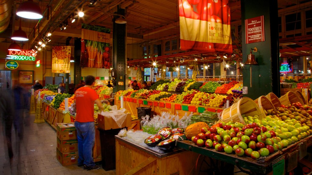 Reading Terminal Market which includes night scenes, interior views and markets