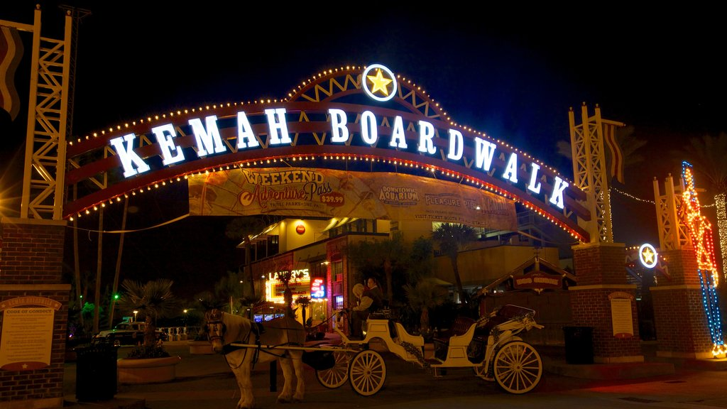 Kemah Boardwalk which includes rides, night scenes and signage