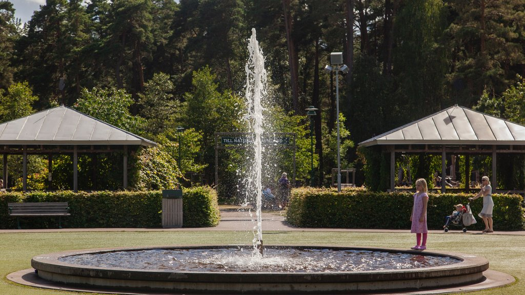 Karlstad featuring a fountain and a garden as well as an individual child