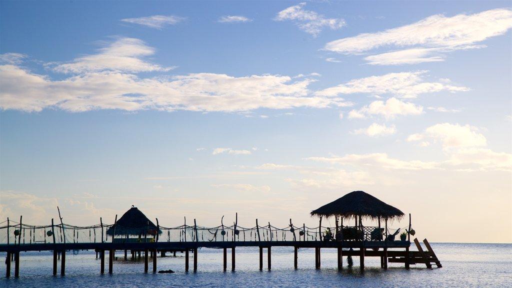Bora Bora which includes a sunset and tropical scenes