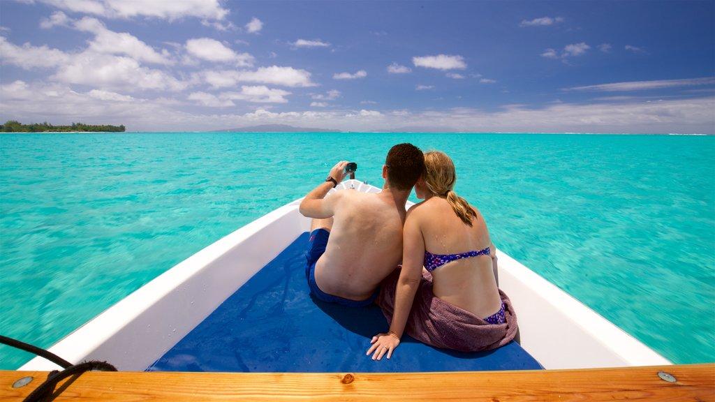 Bora Bora que incluye vistas generales de la costa, paseos en lancha y escenas tropicales