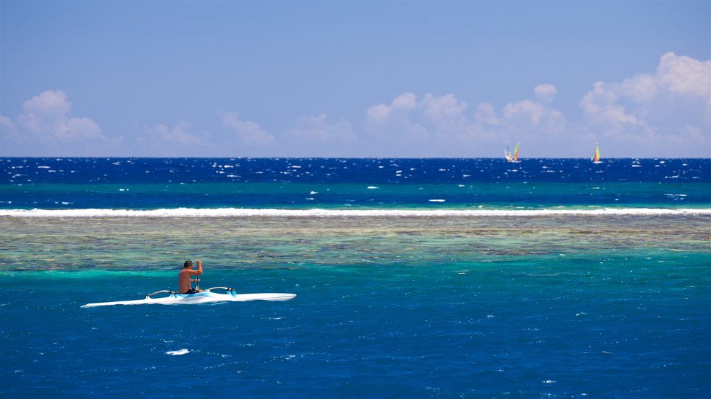 Tahiti showing general coastal views and kayaking or canoeing as well as an individual male