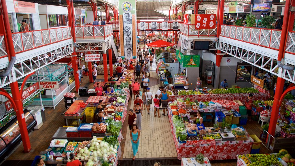 Papeete Market which includes interior views and markets as well as a small group of people