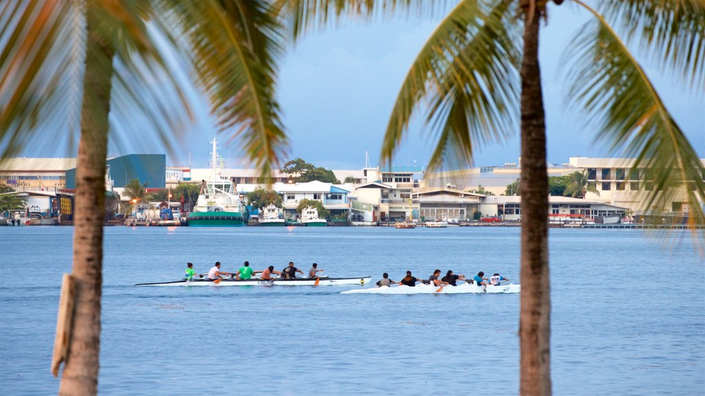 Papeete featuring kayaking or canoeing and tropical scenes as well as a small group of people