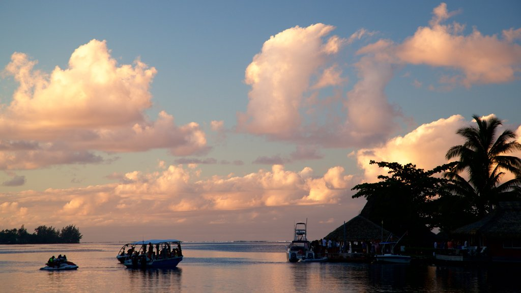 Moorea showing boating, a lake or waterhole and a sunset