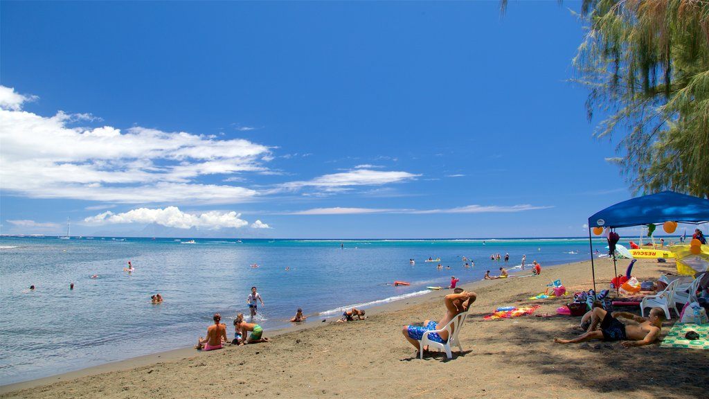 Tahiti featuring general coastal views, a beach and swimming