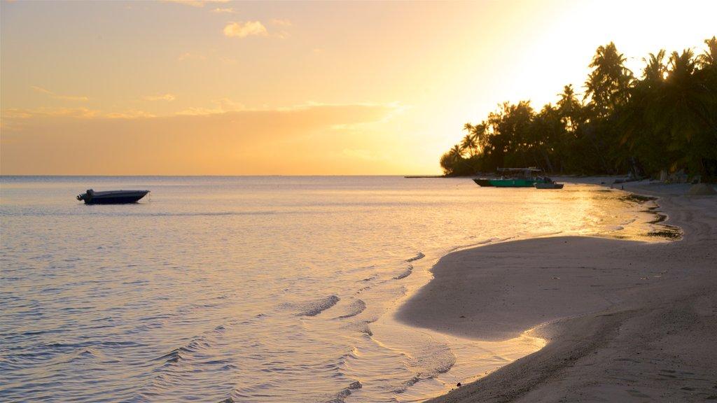 Matira Beach featuring a beach, a sunset and general coastal views
