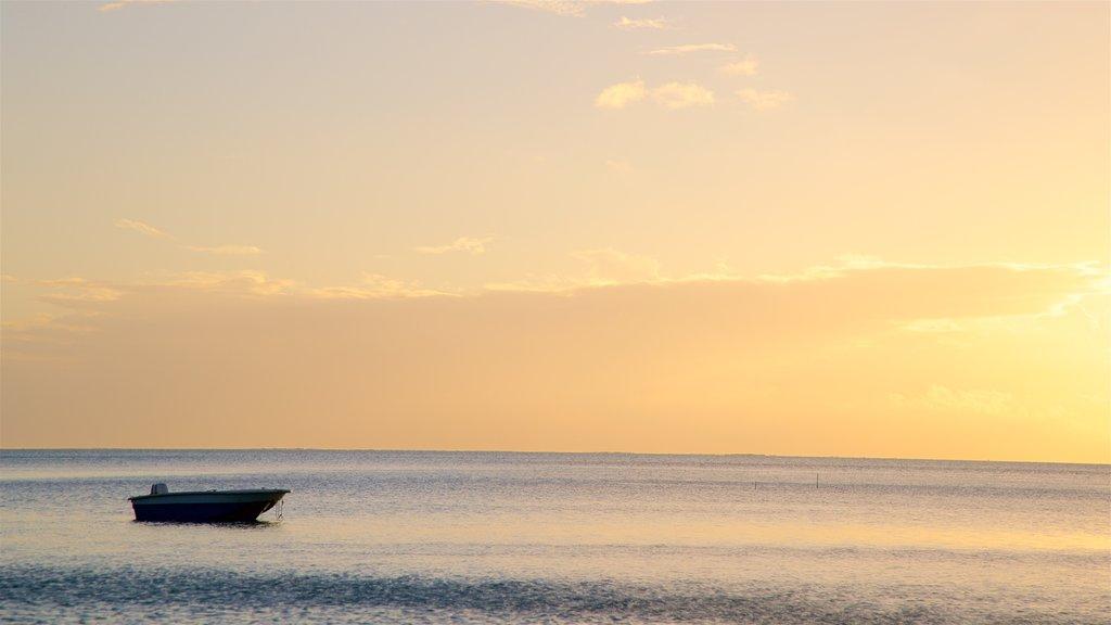 Matira Beach showing a sunset and general coastal views