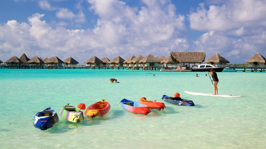 Le Meridien Beach which includes general coastal views, tropical scenes and kayaking or canoeing