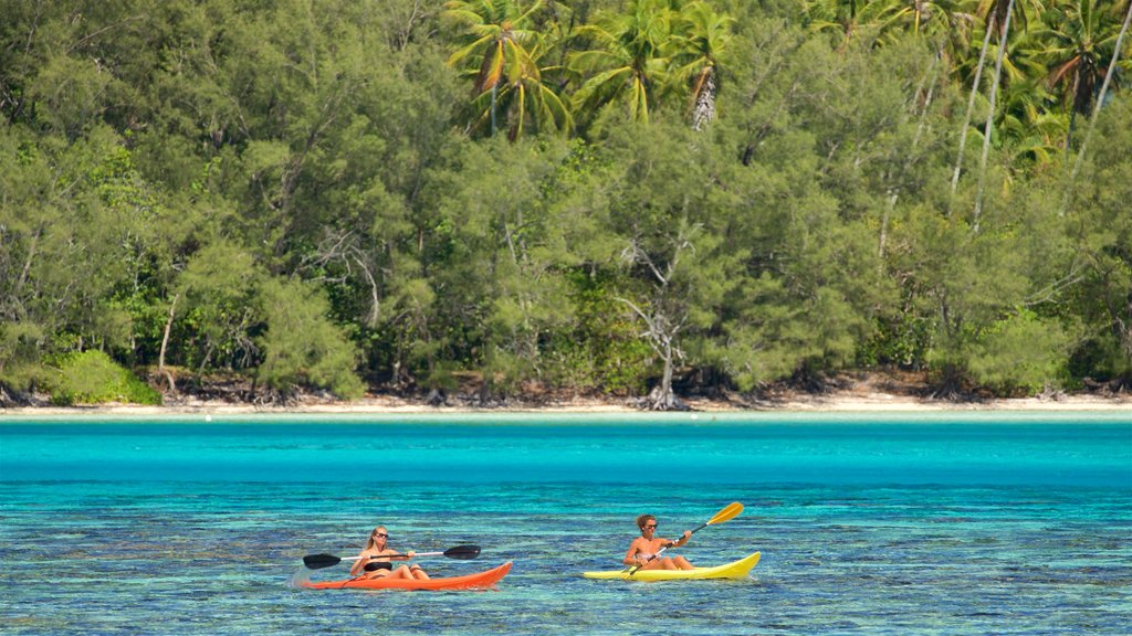 Tiahura Beach featuring kayaking or canoeing and general coastal views as well as a couple