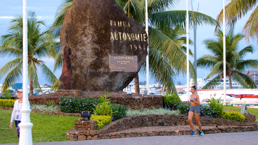 Papeete which includes signage and a garden as well as an individual femail