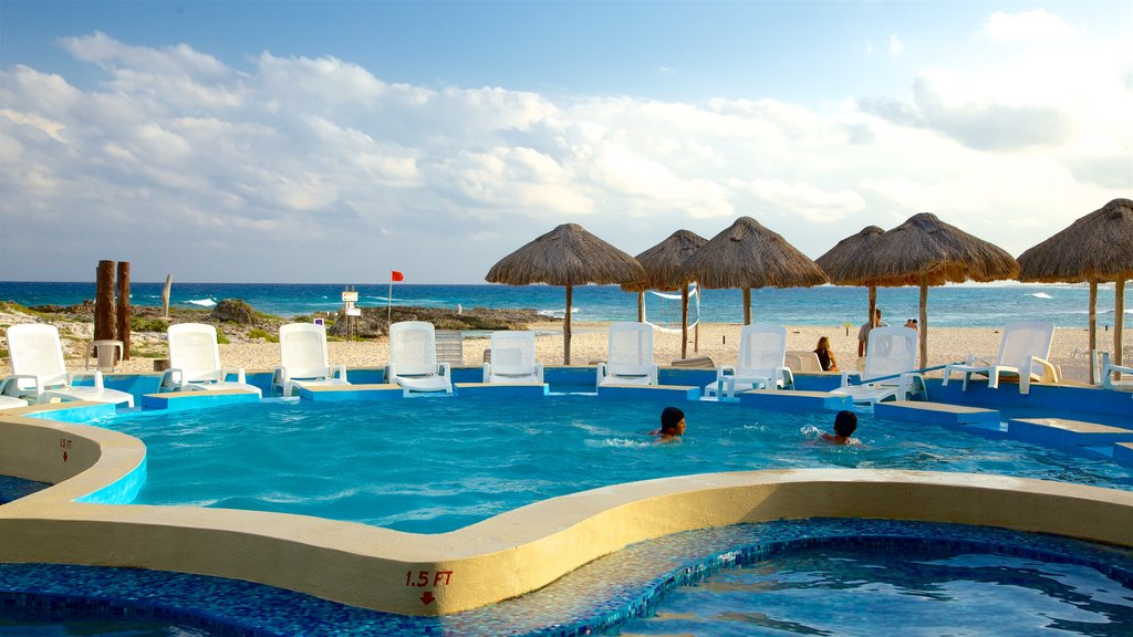Punta Morena which includes swimming, a pool and tropical scenes