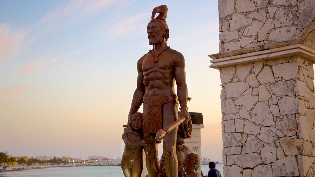 Cozumel which includes a sunset, a statue or sculpture and a monument