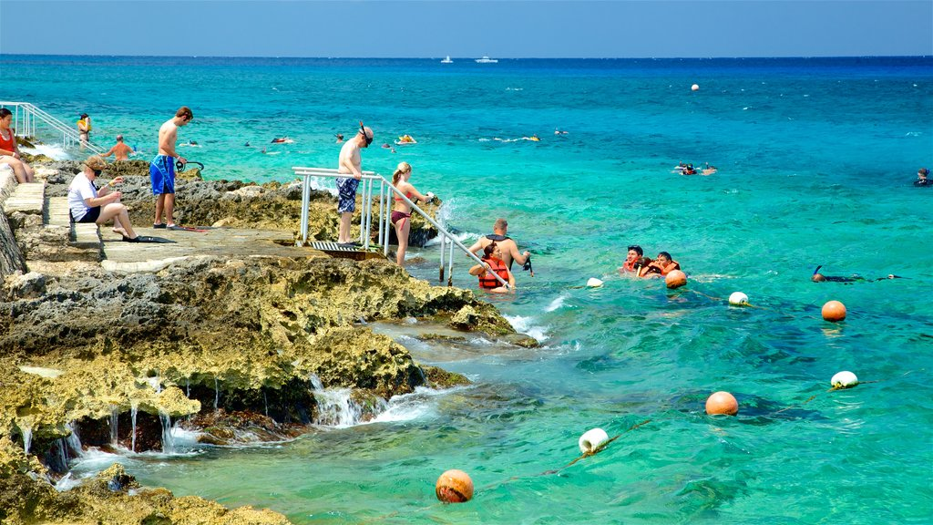 Cozumel featuring rocky coastline, swimming and general coastal views