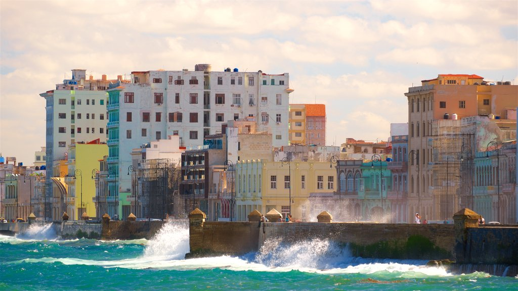 Malecón which includes a sunset and general coastal views