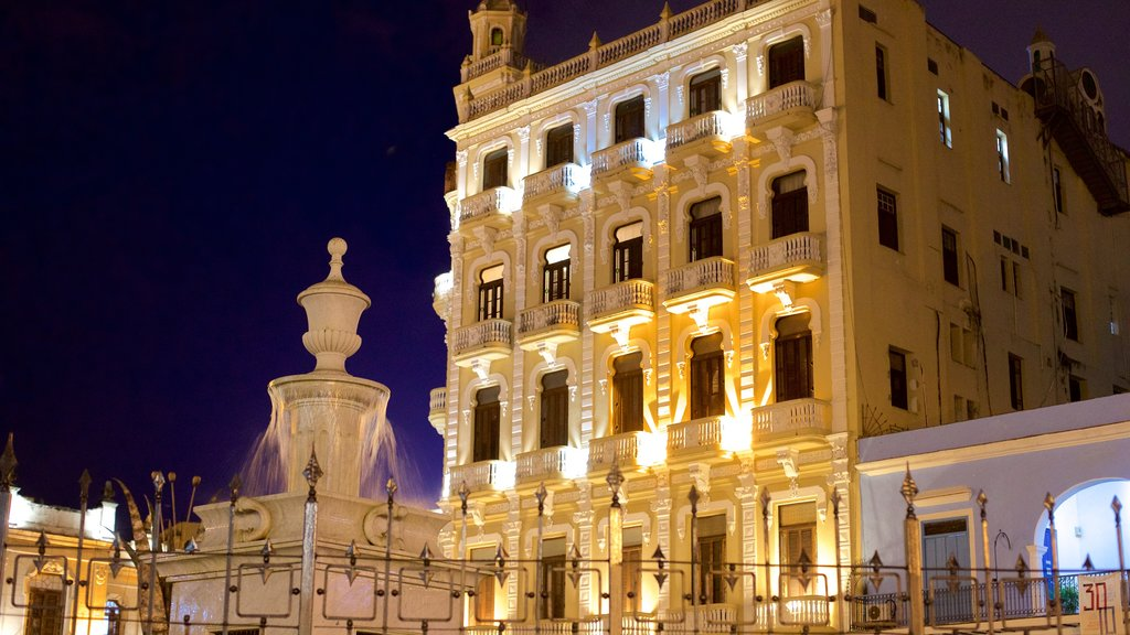 Old Havana which includes night scenes, heritage elements and a fountain