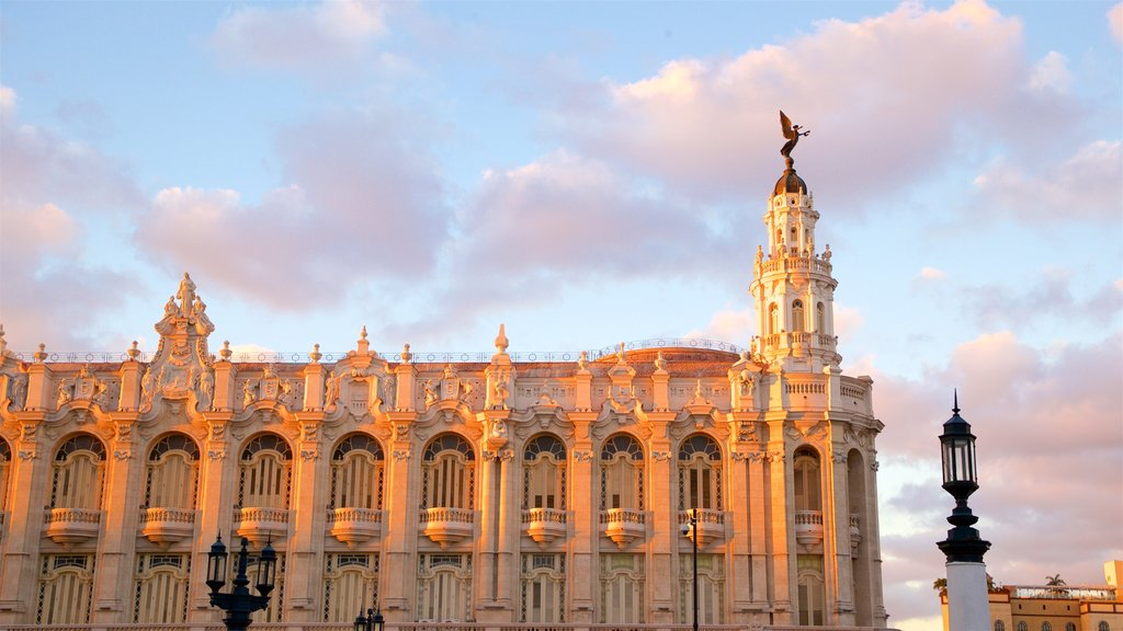 Great Theatre of Havana featuring heritage architecture and a sunset