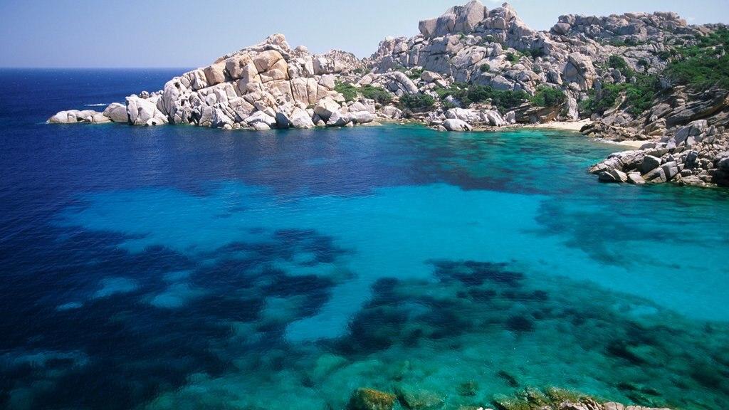 La Maddalena featuring general coastal views, rocky coastline and tropical scenes