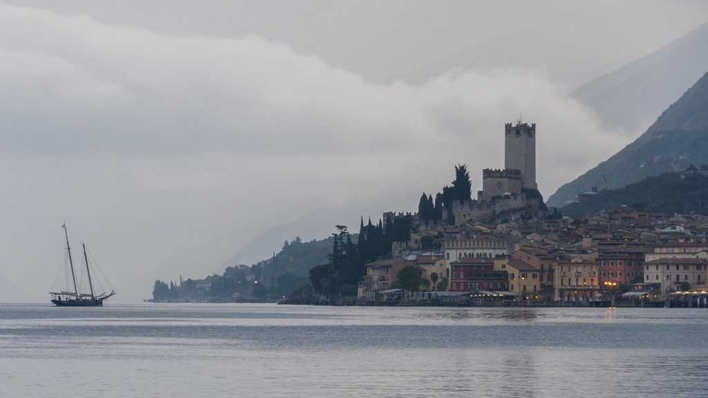 Malcesine featuring a lake or waterhole, mist or fog and a small town or village