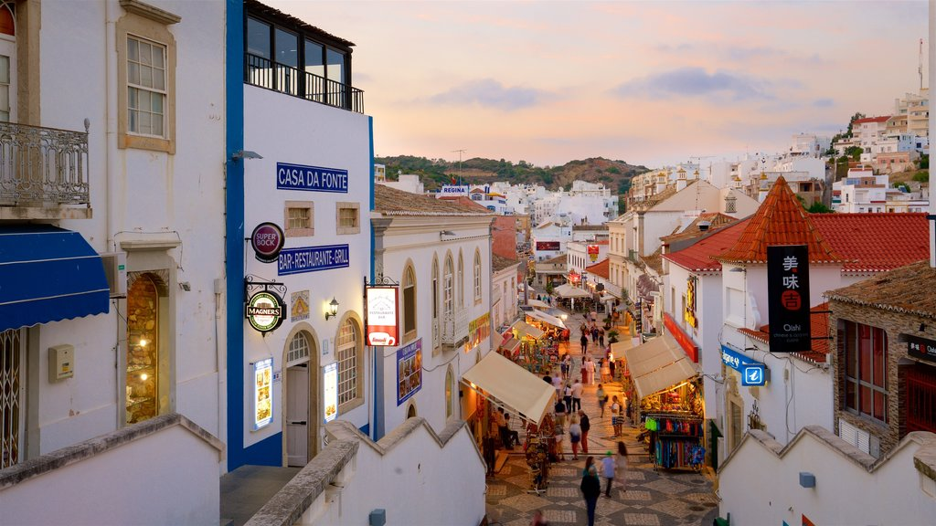 Albufeira Old Town Square showing a sunset and a city