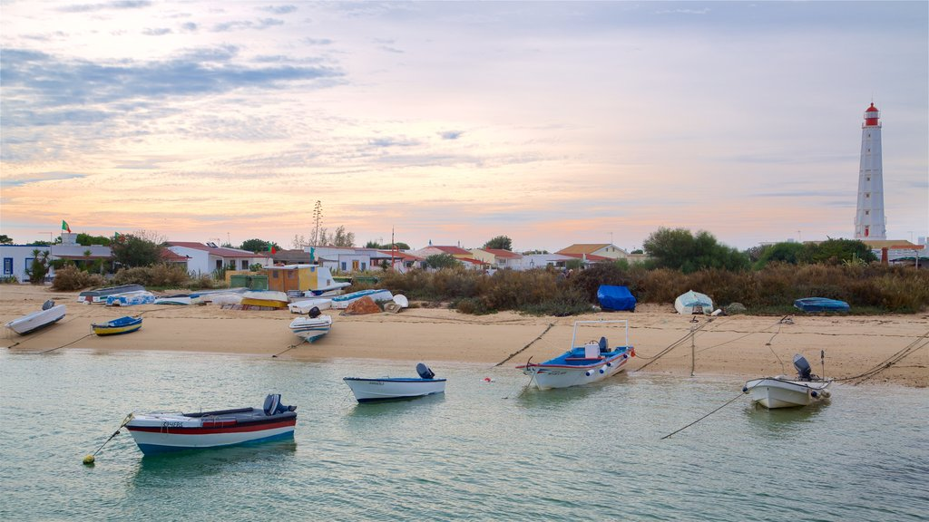 Faro which includes a sunset, a lighthouse and a sandy beach