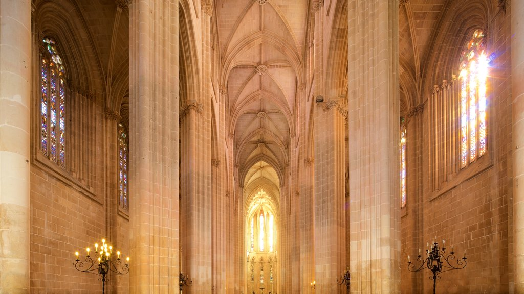 Batalha Monastery which includes heritage elements, interior views and a church or cathedral
