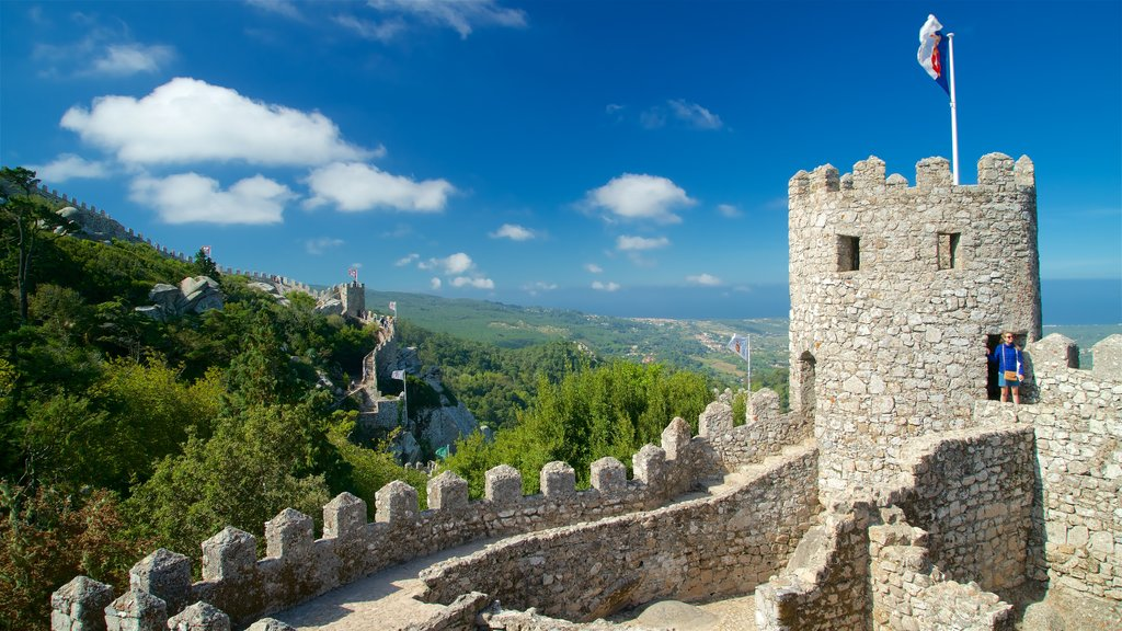 Moorish Castle showing tranquil scenes, heritage elements and chateau or palace
