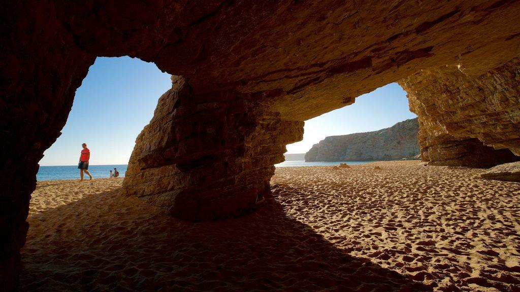 Beliche Beach featuring general coastal views, caves and a beach