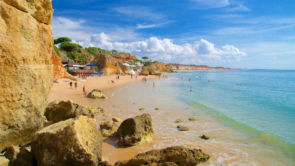 Olhos D\'Agua Beach showing a beach, general coastal views and rugged coastline