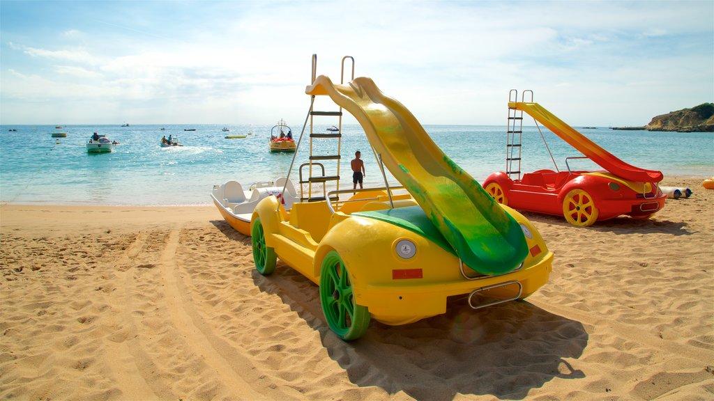 Oura Beach showing a sandy beach and general coastal views
