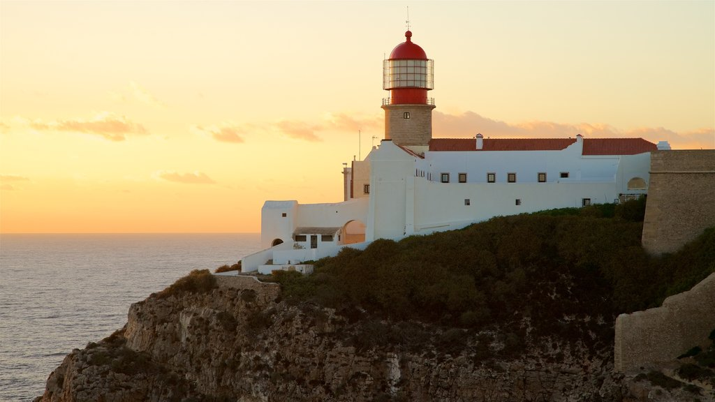 Cape St. Vincent Lighthouse which includes a sunset, general coastal views and a lighthouse