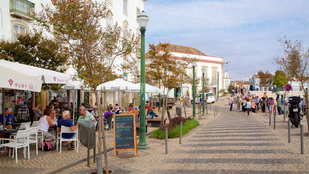 Praca da Republica which includes outdoor eating as well as a small group of people
