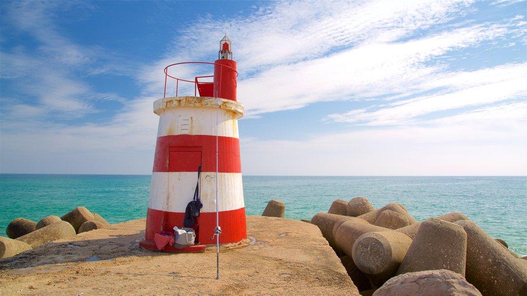 Ilha de Tavira Beach featuring general coastal views and a lighthouse