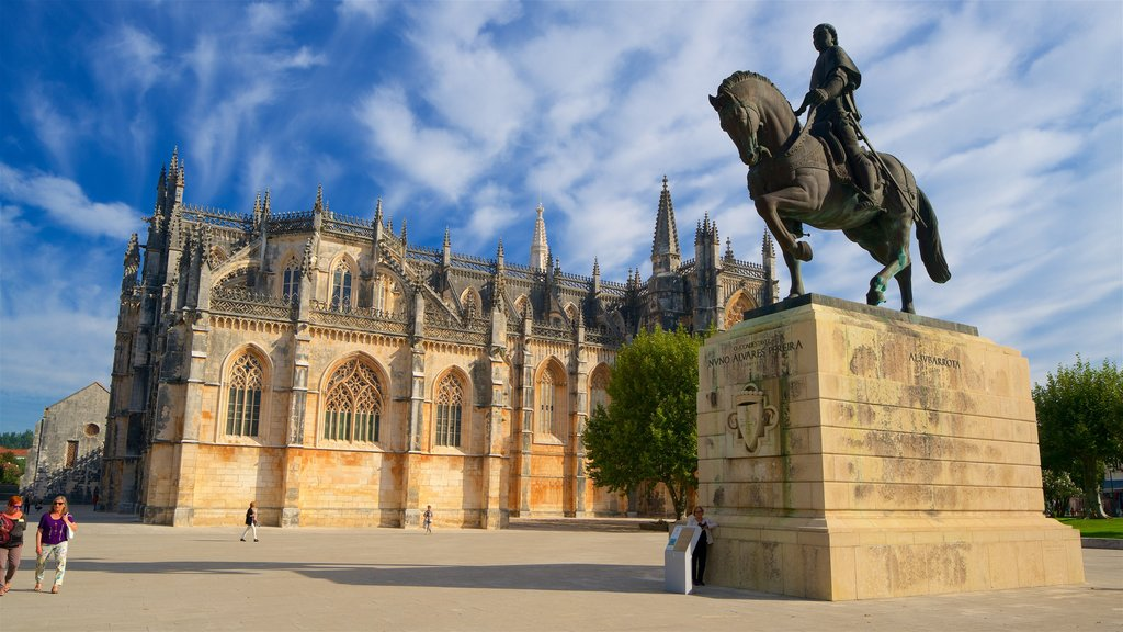Batalha Monastery which includes a statue or sculpture, heritage architecture and a square or plaza