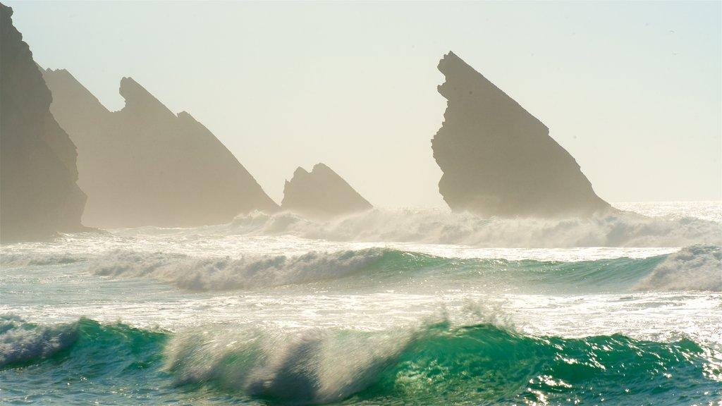 Adraga Beach showing surf, general coastal views and rocky coastline