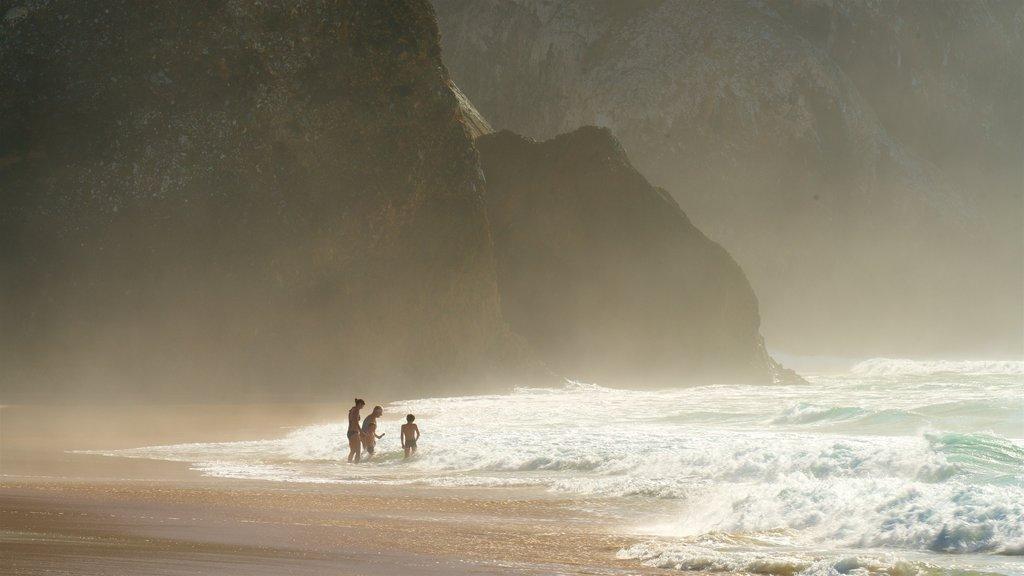 Adraga Beach featuring surf, general coastal views and rocky coastline