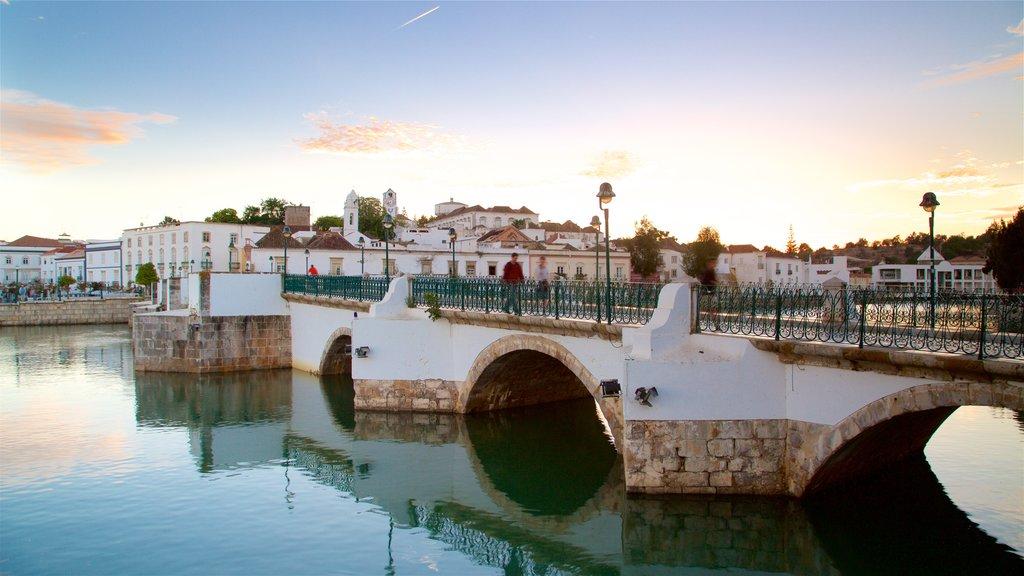 Roman Bridge showing a bridge, a river or creek and a sunset