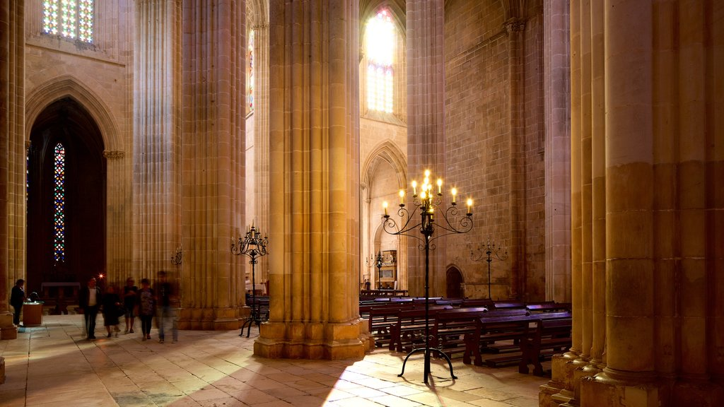 Batalha Monastery showing a church or cathedral, heritage elements and interior views