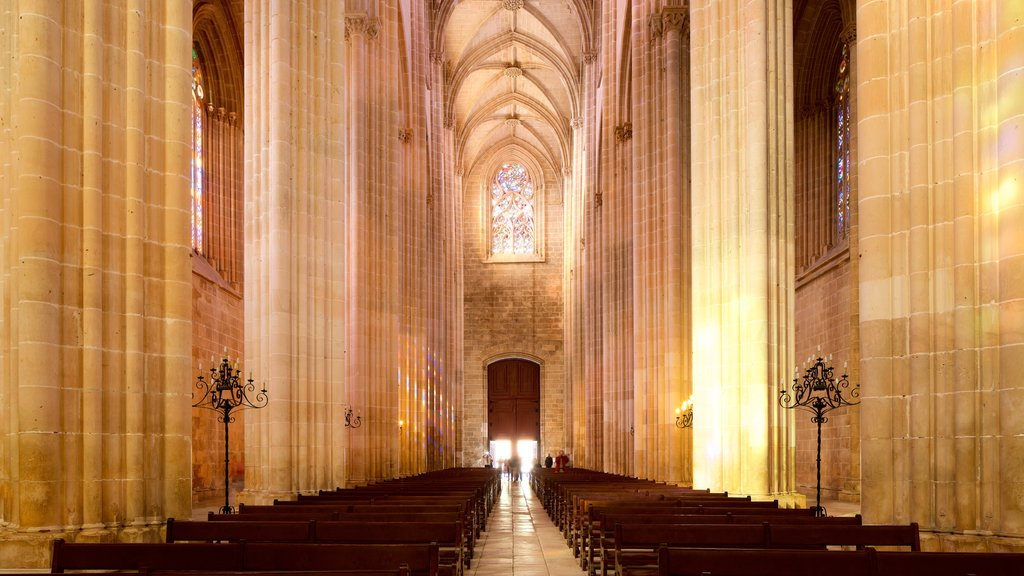 Batalha Monastery which includes a church or cathedral, heritage elements and interior views