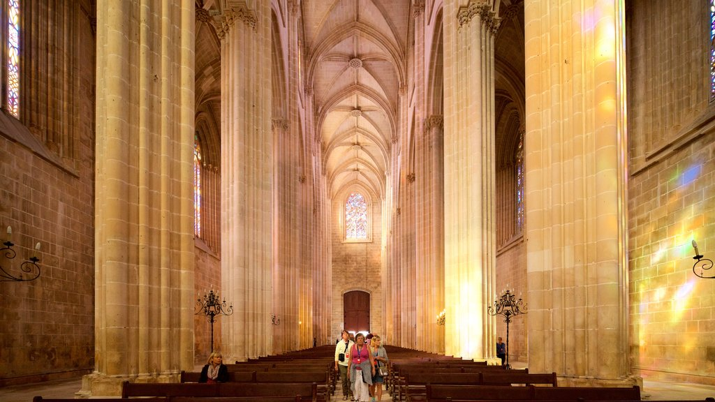 Batalha Monastery featuring a church or cathedral, heritage elements and interior views