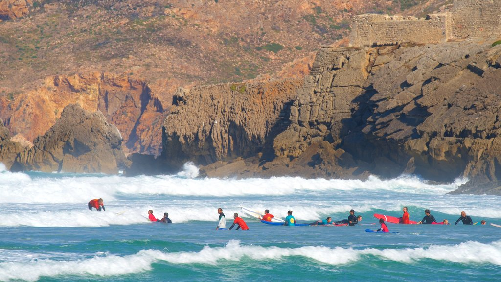 Guincho Beach which includes general coastal views, surfing and rocky coastline