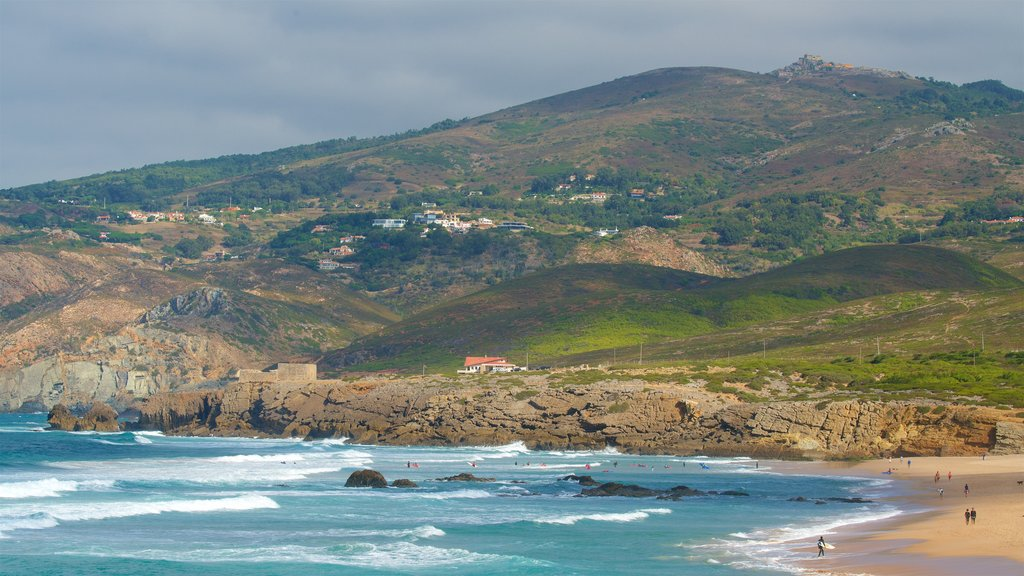Guincho Beach featuring rugged coastline, a beach and tranquil scenes