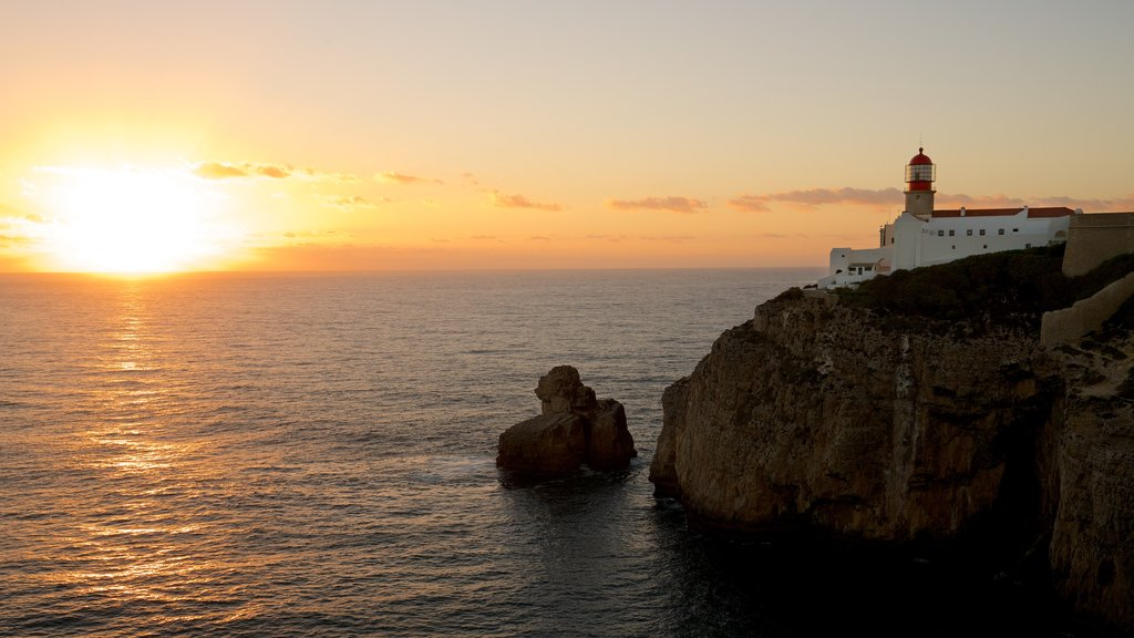 Cape St. Vincent Lighthouse which includes a sunset, a lighthouse and rugged coastline
