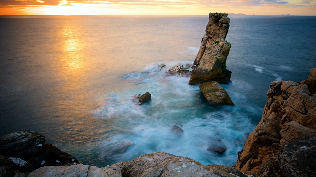 Cabo Carvoeiro showing general coastal views, a sunset and rocky coastline