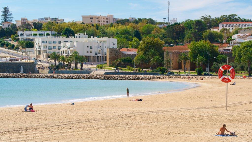 Meia Praia Beach featuring a coastal town, general coastal views and a sandy beach