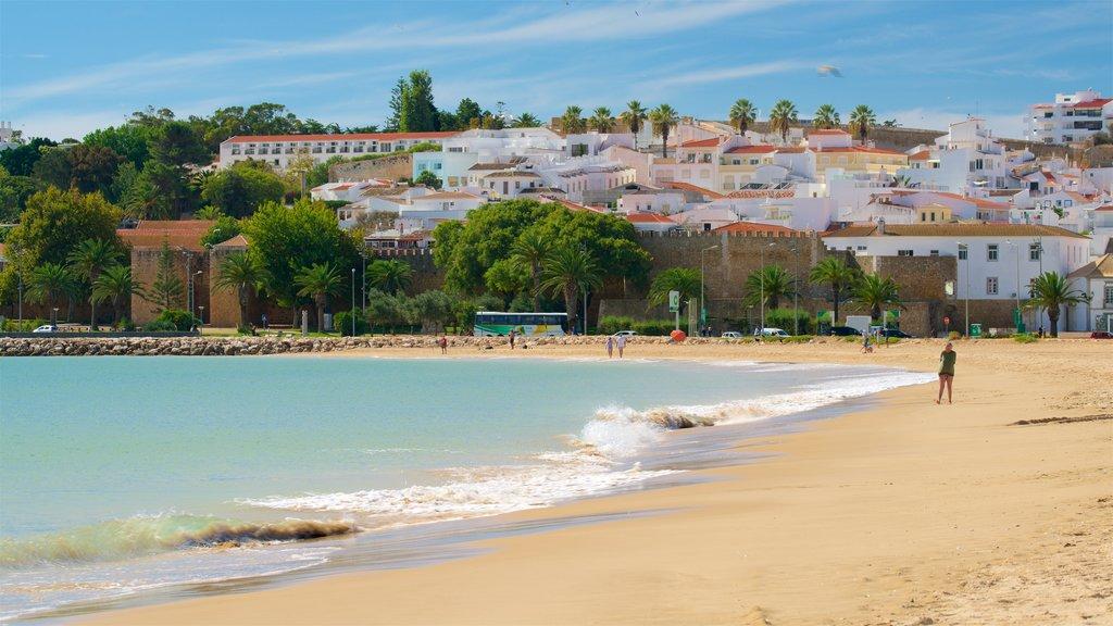 Meia Praia Beach which includes a sandy beach, a coastal town and general coastal views