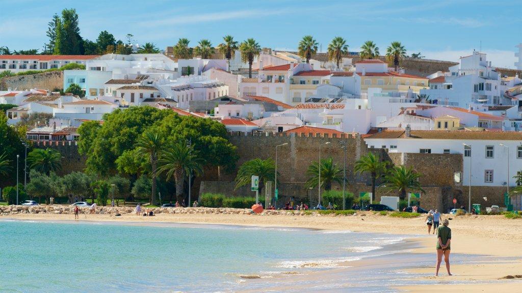 Meia Praia Beach featuring a coastal town, a sandy beach and general coastal views