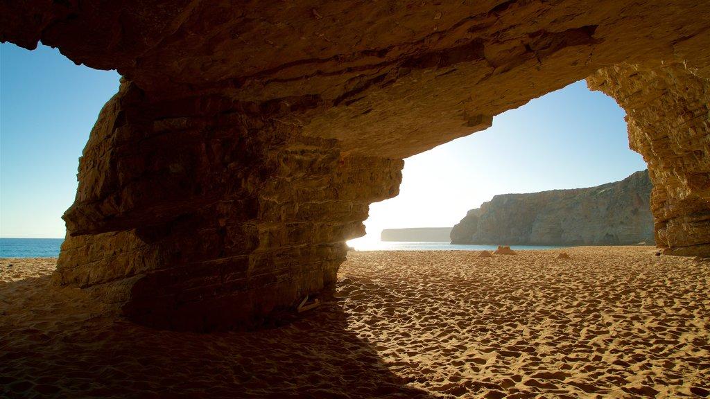 Beliche Beach featuring general coastal views, caves and a sandy beach