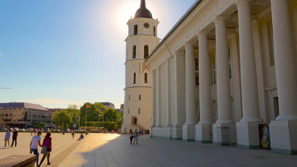 Vilnius Cathedral which includes a square or plaza and heritage elements as well as a small group of people