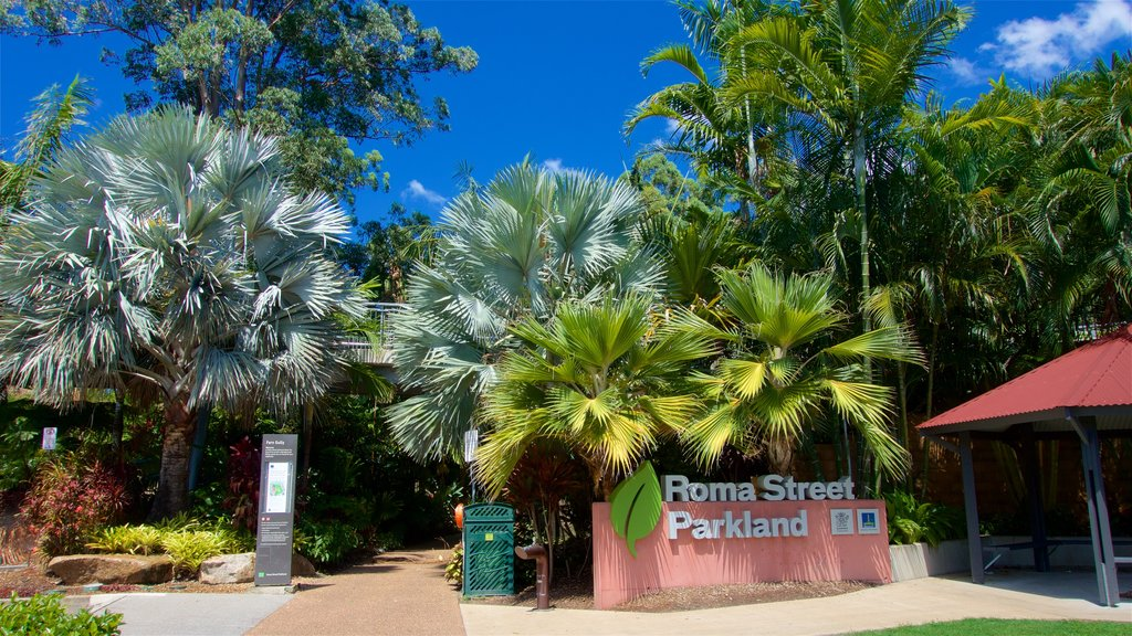 Roma Street Parkland showing signage and a park